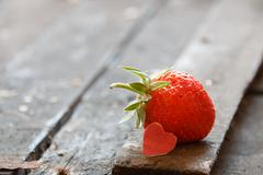 Valentine card: heart  and strawberries Stock Photos