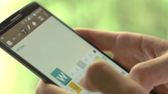 4K Typing Message On Smartphone Keyboard Outdoors Stock Footage