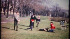 2087 - a family reunion football game in the park - vintage film home movie Stock Footage