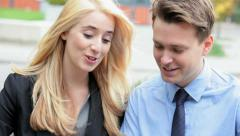 Caucasian business male female executive outdoors touch screen tablet hot spot - stock footage