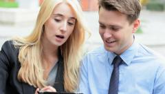 Male female Western Caucasian business shares trader wireless tablet technology Stock Footage