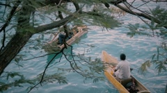 Fishermen in old wooden boat - stock footage