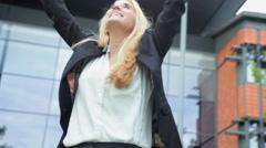 Female business blonde Caucasian triumph reward successful outdoor city broker Stock Footage