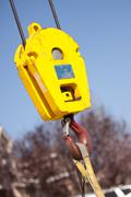 Yellow Utility Industrial Crane Head with Red Hook. Stock Photos
