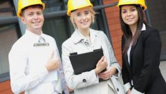 portrait building construction real estate male female Caucasian insurance - stock footage