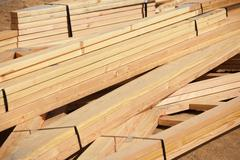 Abstract of Construction Framing Wood Stack. - stock photo