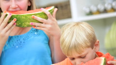young American Caucasian male female child eating low calorie healthy watermelon - stock footage