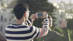 Man Takes A Panorama Photo, But His Friends Play A Joke On Him And Photobomb It Stock Footage