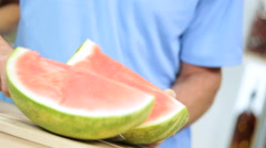 Caucasian family male female couple fresh healthy eating organic watermelon Stock Footage