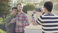 Gay Couple Enjoy Drinks Together, Their Friend Asks To Take Their Photo Stock Footage