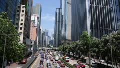 Continuous stream of cars on the Gloucester Road, Hong Kong - stock footage