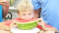 Caucasian family male female parents children fresh healthy organic watermelon - stock footage