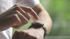 4K Using Smartwatch By Making Gestures Outdoor - stock footage