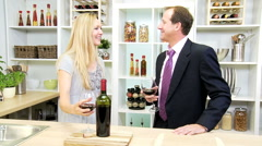 relaxation leisure happy husband wife Caucasian couple luxury home drinking wine - stock footage