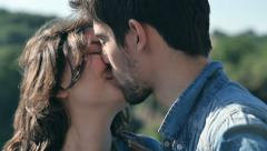 Young people tenderly kissing in slow motion Stock Footage
