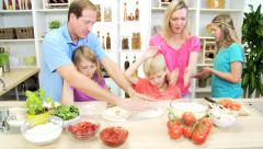 Blonde Caucasian family male female cooking homemade healthy organic pizza Stock Footage