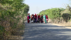 Group of women in traditional clothing walking down the road in Jodhpur. Stock Footage