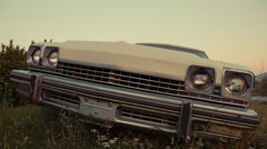 Old abandoned american vintage car in a field (Buick) Stock Footage