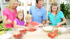 male female Caucasian family parents children fresh healthy organic pizza home - stock footage