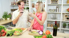 Caucasian male female couple kitchen wireless tablet healthy fresh salad wine Stock Footage