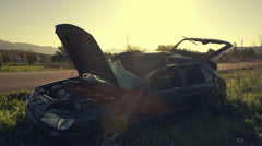 Car wreck,crashed on the side of country road Stock Footage