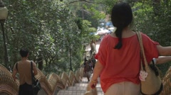 back angle - tourists walking down from Wat Phra That Doi Suthep - stock footage