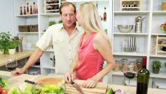 Caucasian male female couple kitchen healthy fresh salad wine social lifestyle - stock footage