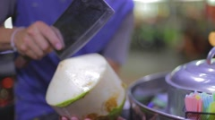 Man chops a fresh coconut juice Stock Footage