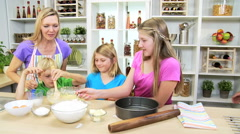 Caucasian family parents children cooking baking kitchen leisure confectionery Stock Footage