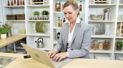 Caucasian businesswoman home kitchen wireless laptop freelance financial advisor Stock Footage