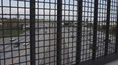 Freeway View through Fence Line 2 Stock Footage