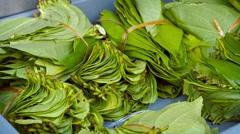 Betel Leaves Bundled for Sale at Market Stock Footage