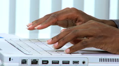 Fingers typing African American business female wireless laptop technology Stock Footage