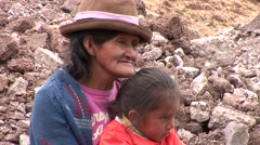 PERU: Poor Woman with her daughter on a waste dump Stock Footage