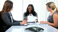 Female African American European business manager trader shares wireless laptop Stock Footage