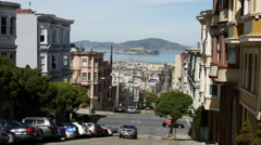 Steep street of San Francisco with view at Alcatraz Stock Footage