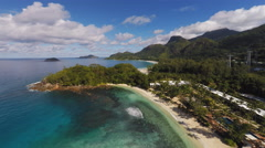 Aerial tropical island fly over  - stock footage