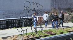 People walk on the highline walk NYC - stock footage