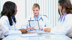 Caucasian African American female doctor medical technology laptop tablet - stock footage