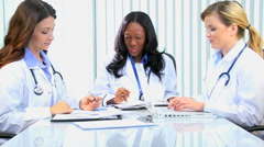 Multi ethnic female medical consultant financial planning wireless technology Stock Footage