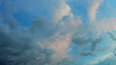 Fluffy Clouds at Sunset, Gradually Changing Color in the Fading Light Stock Footage