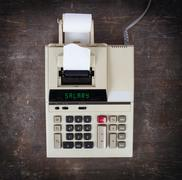 Old calculator - salary - stock photo