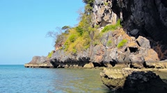 Crumbling Cliff Face along a Tropical Coastline - stock footage