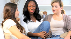 Young Western African American girls friends social home casual clothing Stock Footage