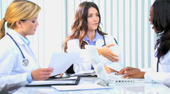 handshake multi ethnic female medical consultant financial planning technology - stock footage