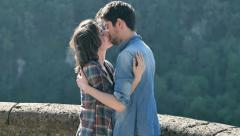 People in love: young man and young woman kissing after been embraced Stock Footage
