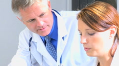 Caucasian Western male female doctor consultant medical computer technology - stock footage