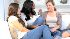 African American Western Caucasian girls female lifestyle relaxation together Stock Footage