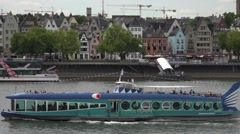 ULTRA HD 4K Pan left touristic ferry cruise dolphin shaped Koln cityscape trip - stock footage