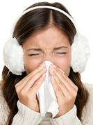 Flu or cold sneezing woman - girl sick blowing nose portrait - stock photo